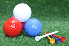 Golf balls and tees. Golf balls pyramide and tees Royalty Free Stock Image