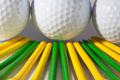 Golf balls and tees. White golf balls and different tees Stock Image