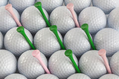 Golf balls and tees. White golf balls and different green and pink tees Stock Photography