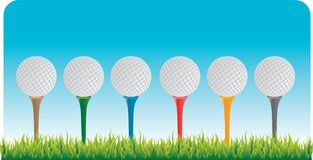 Golf balls on tees. Six golf balls on multiple colored tees Stock Photography