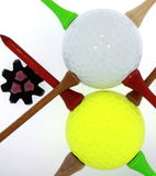 Golf Balls With Tees and Cleat. Closeup of golf balls with assorted tees and cleat isolated on white Stock Images