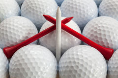 Golf balls and tees. White golf balls and different tees Stock Photos
