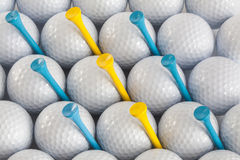 Golf balls and tees stock image