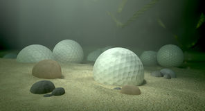 Golf Balls In Water Hazard. An underwater scene of a golf water hazard with a few golf balls laying on the sand bottom Royalty Free Stock Photo