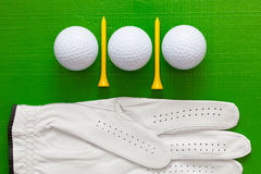 Golf balls and wooden golf tees on the green table Stock Photo