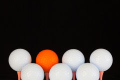Golf balls and wooden tees Stock Image