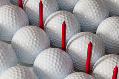 Golf balls and wooden tees in open box. White golf balls and  different wooden tees Stock Photography