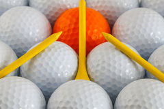 Golf balls and wooden tees. White golf balls and wooden tees Stock Photos