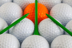 Golf balls and wooden tees. White golf balls and wooden tees Royalty Free Stock Image