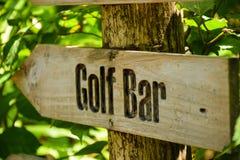 Golf bar wooden sign at the tropical island. Golf bar wooden sign showing direction at the tropical island at Maldives Stock Images