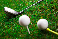 Golf bat and balls. Golf ball on the green grass. Studio Shot Stock Image