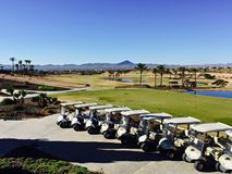 Golf buggies lined up in front of the course in Hacienda del Alamo, Murcia, Spain royalty free stock photography