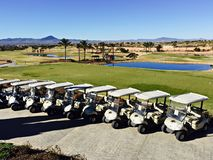 Golf buggies lined up in front of the course in Hacienda del Alamo, Murcia, Spain royalty free stock photo