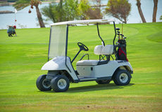 Golf buggy on a fairway. Electric golf buggy parked on the fairway of a golf course stock image