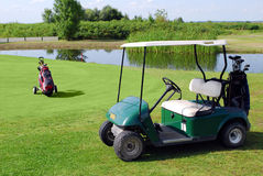 Golf buggy and golf bag. On golf field royalty free stock images