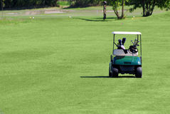 Golf buggy on golf field Royalty Free Stock Photo