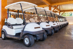 Golf buggy parked. Many in a row. Stock Photos