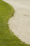 Golf bunker and grass Stock Images