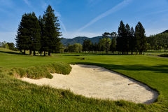 Golf bunker or sand trap in fairway Royalty Free Stock Photo