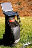Golf and Business Laptop. An empty golf bag with a laptop computer on top using it as a desk stock photo