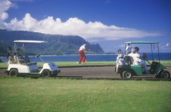 Golf Caddies and carts on course in Pacific Princeville, Kauai, HI Stock Images