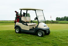 Golf car. With equipment on golf cource Royalty Free Stock Photos