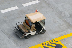 Golf car. In naval dock, caribbean sea Stock Photography