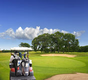 Golf car on the field Royalty Free Stock Image
