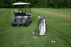 Golf-car and golf-clubs Royalty Free Stock Images