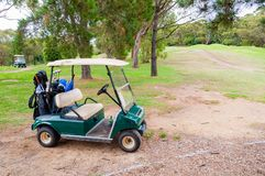 Golf car on green lawn of golf course Royalty Free Stock Image