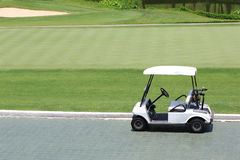 Golf car in golf course Royalty Free Stock Photo