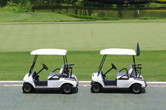 Golf car in golf course Stock Photo