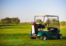 Golf car on the golf course Royalty Free Stock Image