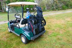 Golf car on green lawn of golf course Royalty Free Stock Photography