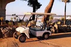 Golf car parked in outdoors on a sunny spring day stock photography