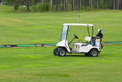 Golf car. White car to get around the Golf course Royalty Free Stock Images