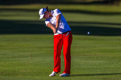 Golf Caroline Masson Strike Ball. Lady Pro Golfer Caroline Mason from Germany hits a long iron at par five in final round of Ladies Professional Golf  at Stock Image