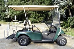 Golf cars. On the field royalty free stock photography