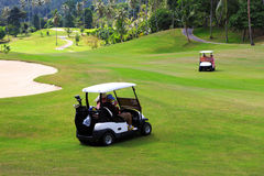 Golf cars on the golf course Royalty Free Stock Photo