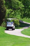Golf Cart. On the green at the golf course Royalty Free Stock Photography