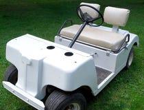 Golf cart. White golf cart in a garden Royalty Free Stock Photos