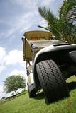 Golf Cart. Parked on fairway. Low angle view on hill stock photography