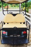 Golf cart or club car park on the way to modern village Royalty Free Stock Photos