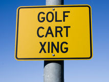 Golf Cart Crossing Sign. Real Golf Cart Crossing sign against a clear blue sky royalty free stock photo