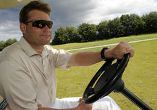 Golf cart driver Stock Photo