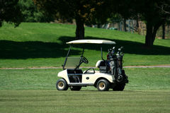 Golf cart on the fairway of a course Stock Photos