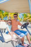 Golf cart with father and his little daughters Stock Photography