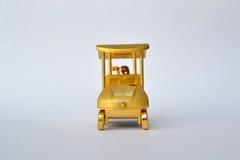 Golf cart and golf bag gold reward Stock Photos
