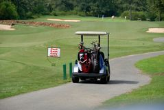 Golf cart on golf course royalty free stock photos