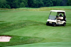 Golf cart on golf course Royalty Free Stock Images